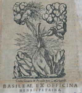 Znak wydawcy, Heinricha Petriego, na stronie tytułowej drugiego wydania dzieła M. Kopernika De revolutionibus…, Bazylea 1566. Kolekcja Muzeum Polskiego w Rapperswilu