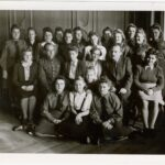 """Group photograph of girls from the """"Wola""""."""